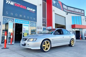 HOLDEN COMMODORE WITH GOLD SIMMONS FR1 WHEELS  |  | HOLDEN